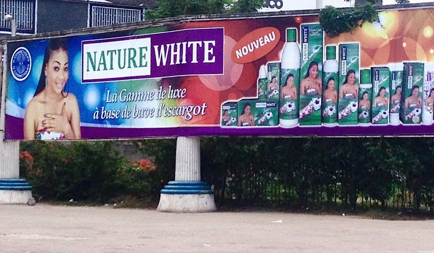 "Advertisements like this one for Nature White cosmetics are common in Abidjan, the economic capital of Ivory Coast. This ad claims to offer ""the spectrum of luxury"" with its snail slime-based products."