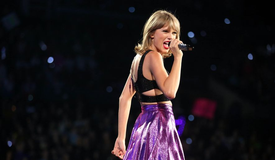 "Taylor Swift performs during the ""1989"" world tour at Staples Center in Los Angeles, in this Aug. 22, 2015, file photo. Swift earned six American Music Awards nominations announced Tuesday, Oct. 13, and if she wins everything she's up for the singer will become the most-honored female artist in the show's history. The awards show will be held from Los Angeles on Sunday, Nov. 22 at 8 p.m. EST on ABC. (Photo by Matt Sayles/Invision/AP, File)"