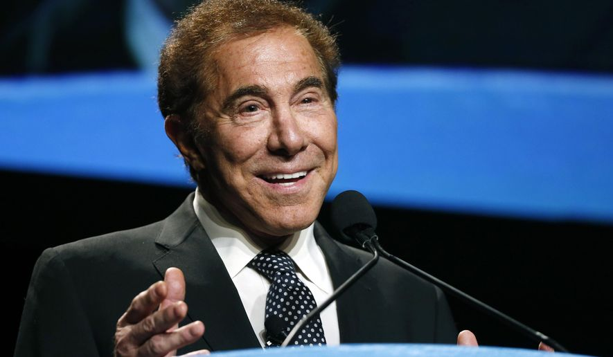 FILE - In this Jan. 15, 2015 file photo, Wynn Resorts CEO Steve Wynn delivers the keynote address at Colliers International Annual Seminar at the Boston Convention Center in Boston. Wynn, who leans Republican, is hosting the Tuesday, Oct. 13, 2015 Democratic presidential debate at his Wynn Las Vegas resort-casino. (AP Photo/Elise Amendola, File)
