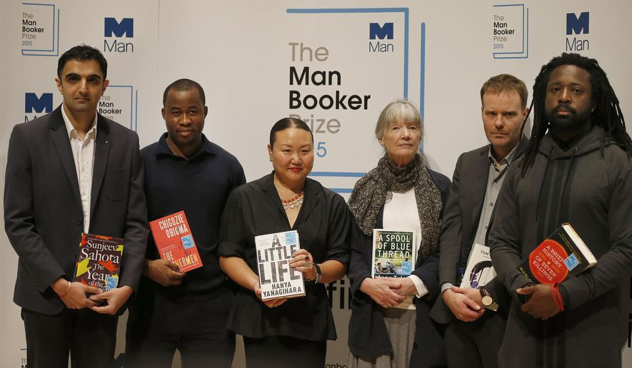 Authors nominated for the 2015 Man Booker Prize; from left,  Sunjeev Sahota,  Chigozie Obioma, Hanya Yanagihara, Anne Tyler, Tom McCarthy and Marlon James pose with their books on stage at the Royal Festival Hall in London, Monday, Oct. 12, 2015. The six authors are short-listed for the 2015 Man Booker Prize for Fiction, and the winner will be announced Tuesday Oct. 13. (AP Photo/Frank Augstein)