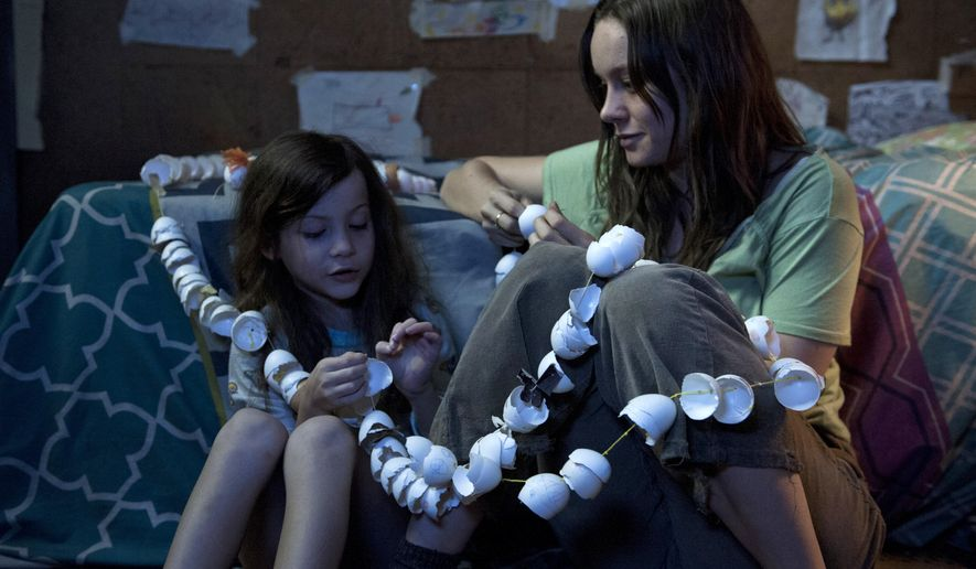 "In this image released by A24 Films,  Brie Larson, right, and Jacob Tremblay appear in a scene from ""Room."" (George Kraychyk/A24 Films via AP)"