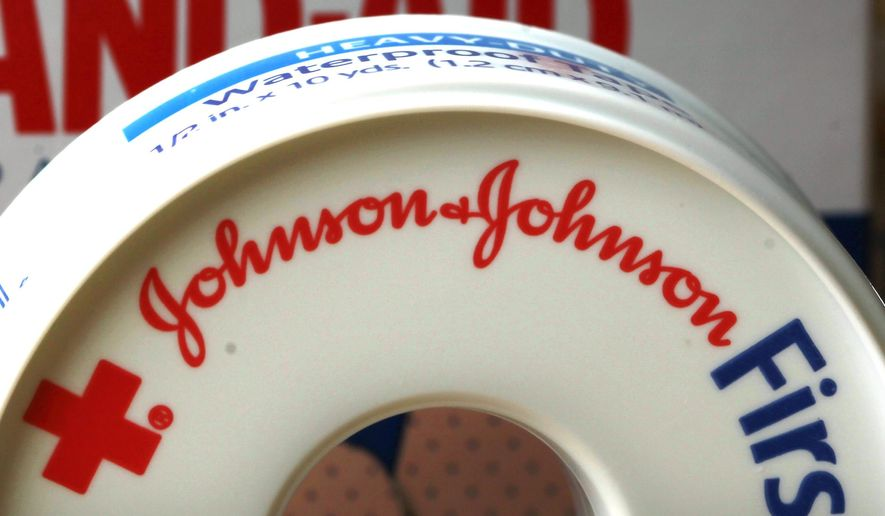 FILE - In this Monday, July 16, 2012, file photo, Johnson & Johnson products are displayed in Orlando, Fla. Johnson & Johnson reported, Tuesday, Oct. 13, 2015, a 29 percent drop in third-quarter earnings, hammered by plunging sales of its hepatitis C medicine and unfavorable currency exchange rates that reduced the value of overseas sales. Its year-ago results had also included a big gain from selling a diagnostics business. (AP Photo/John Raoux, File)