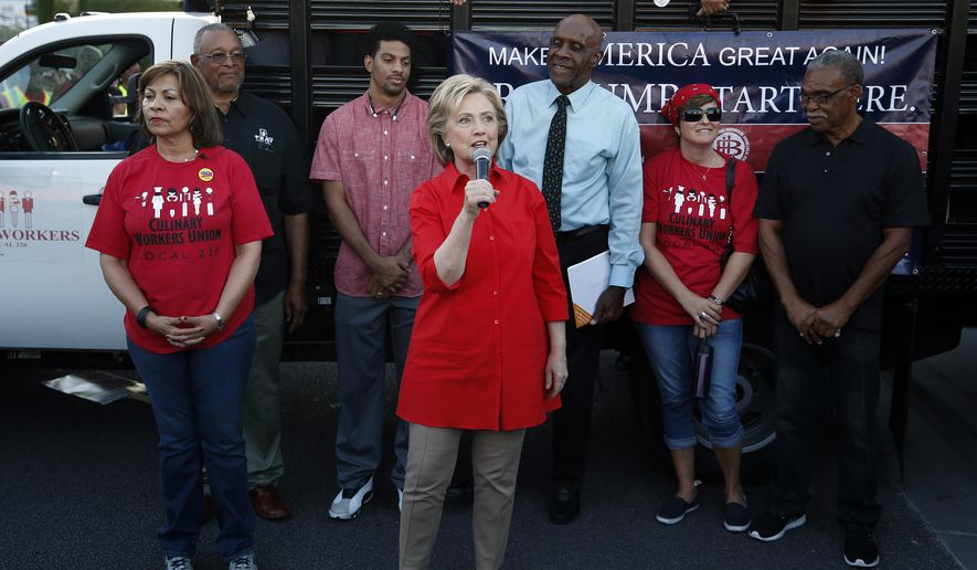 Democratic presidential candidate Hillary Rodham Clinton speaks during a rally Monday, Oct. 12, 2015, in Las Vegas, held by the Culinary Union to support a union drive at the Trump Hotel in Las Vegas. (AP Photo/John Locher)