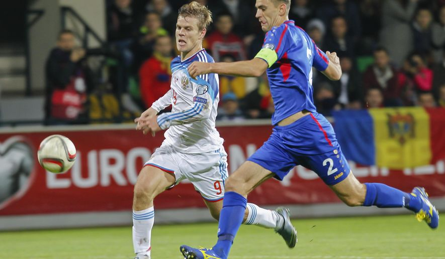 Moldova's Vitalie Bordian, right, fights for the ball with Russia's Aleksandr Kokorin, left,  during the Euro 2016 group G, qualifying match between Moldova and Russia, at the Zimbru Stadium, in Chisinau, Moldova, Friday, Oct. 9, 2015. (AP Photo/Roveliu Buga)