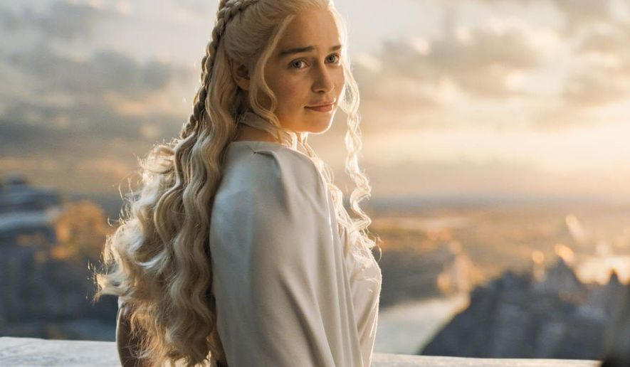 "In this image released by HBO, Emilia Clarke appears in a scene from ""Game of Thrones."" The 28-year-old Clarke, who plays menacing, white-haired Daenerys Targaryen, aka Khaleesi, aka Mother of Dragons on ""Game of Thrones,"" is Esquire's Sexiest Woman Alive. The magazine made the announcement early Tuesday, Oct. 13.  (HBO via AP)"