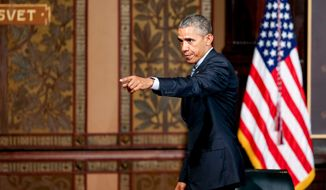 President Barack Obama points to the audience as he departs after speaking at the Catholic-Evangelical Leadership Summit on Overcoming Poverty at Gaston Hall at Georgetown University in Washington, Tuesday, May 12, 2015. (Associated Press photo)