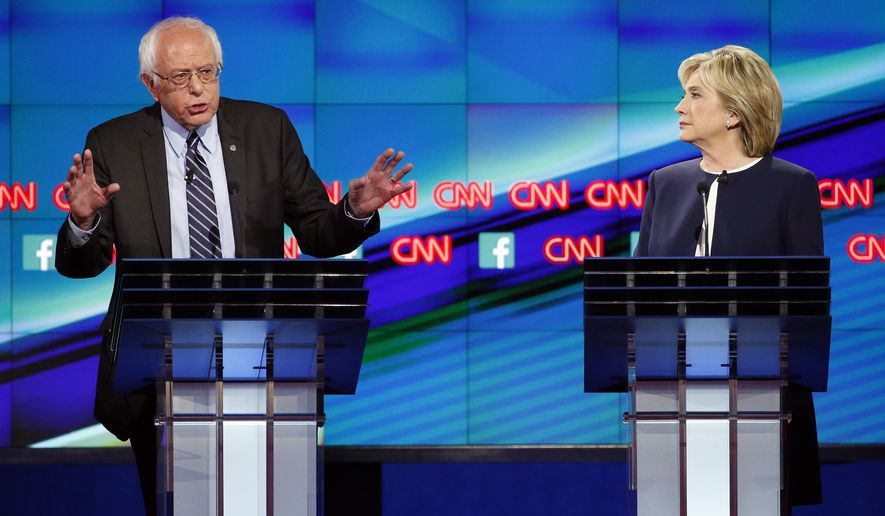 Sen. Bernie Sanders,of Vermont, left, speaks as Hillary Rodham Clinton listens during the CNN Democratic presidential debate Tuesday, Oct. 13, 2015, in Las Vegas. (AP Photo/John Locher)