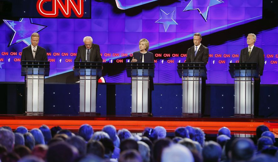 Democratic presidential candidates from left, former Virginia Sen. Jim Webb, Sen. Bernie Sanders, of Vermont, Hillary Rodham Clinton, former Maryland Gov. Martin O'Malley, and former Rhode Island Gov. Lincoln Chafee take the stage during the CNN Democratic presidential debate Tuesday, Oct. 13, 2015, in Las Vegas. (AP Photo/John Locher)