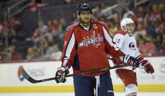 Washington Capitals left wing Alex Ovechkin (8), of Russia, looks on during the second period of an NHL preseason hockey game against the Carolina Hurricanes, Monday, Sept. 21, 2015, in Washington. (AP Photo/Nick Wass)