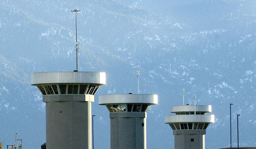 In this Feb. 21, 2007, file photo, guard towers loom over the administrative maximum security federal prison called Supermax near Florence, Colo. Senior U.S. officials said on Friday, Oct. 2,2015, that a Defense Department team will be visiting Colorado State Penitentiary in Canon City and the so-called Supermax federal prison in Florence to assess their possible use to house detainees from Guantanamo Bay, Cuba, as part of the Obama administration's plan to close that detention center. (Chris McLean(/The Pueblo Chieftain via AP)