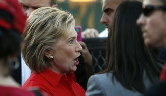 Democratic presidential candidate Hillary Rodham Clinton arrives at a rally Monday, Oct. 12, 2015, in Las Vegas, held by the Culinary Union to support a union drive at the Trump Hotel in Las Vegas. (AP Photo/John Locher)
