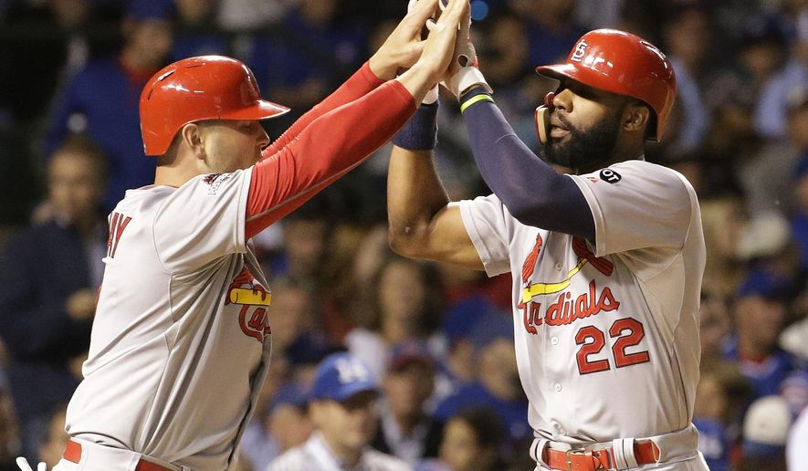 St. Louis Cardinals' Jason Heyward (22) celebrates with Matt Holliday (7) after hitting a home run against the Chicago Cubs during the sixth inning of Game 3 in baseball's National League Division Series, Monday, Oct. 12, 2015, in Chicago. (AP Photo/Nam Y. Huh)