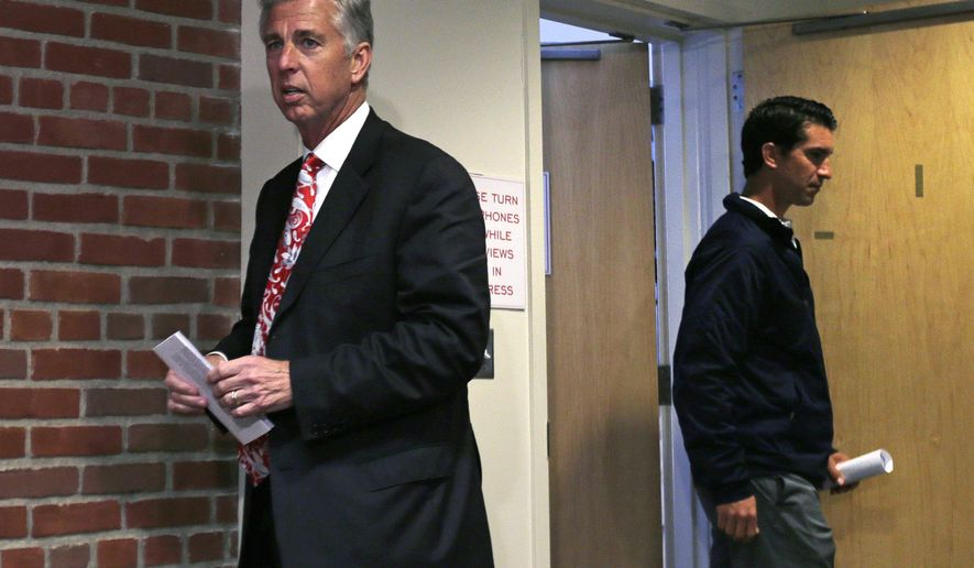 Boston Red Sox President of Baseball Operations Dave Dombrowski, left, arrives with Mike Hazen, the Red Sox general manager, for a baseball news conference at Fenway Park in Boston, Tuesday, Oct. 13, 2015. (AP Photo/Charles Krupa)