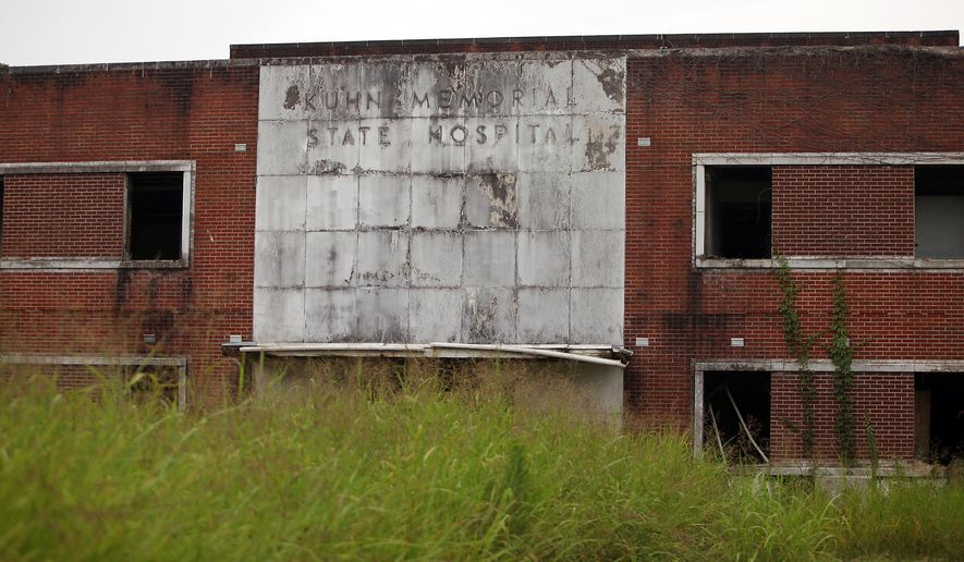 This July 2015 photo shows the former Kuhn Memorial Hospital on Martin Luther King Jr. Boulevard in Vicksburg, Miss. The city of Vicksburg is going to the state to seek a $600,000 low interest loan from the Mississippi Development Authority to help it raze and clean up the site where Kuhn Memorial State Hospital once operated. (Justin Sellers/The Vicksburg Evening Post via AP) MANDATORY CREDIT