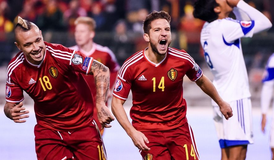 Belgium's Dries Mertens, center, celebrates with Radja Nainggolan, left, after he scored against Israel during a Group B Euro 2016 qualifying soccer match between Belgium and Israel at the King Baudouin stadium in Brussels on Tuesday, Oct. 13, 2015. (AP Photo/Geert Vanden Wijngaert)