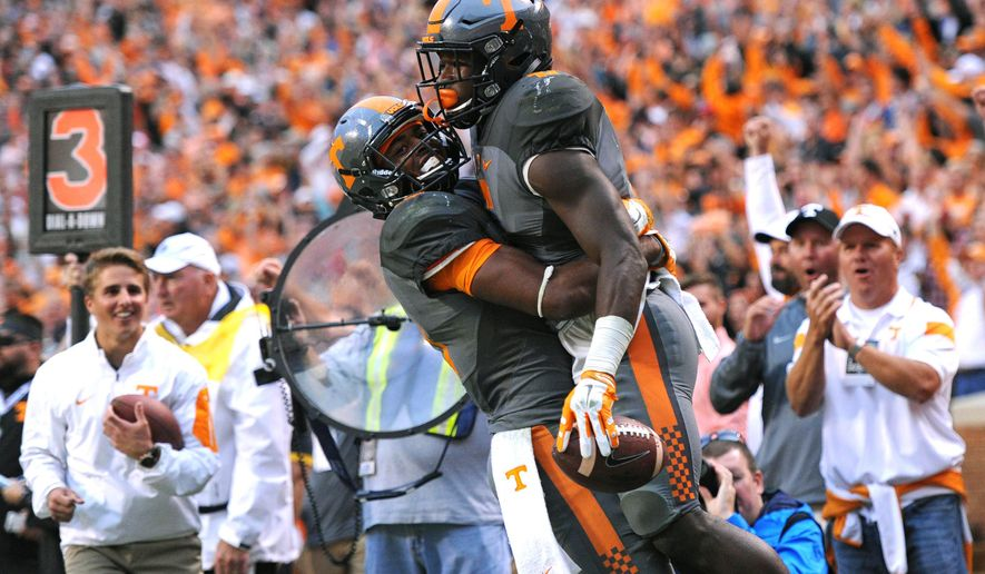 Tennessee wide receiver Jauan Jennings (15), left, celebrates with running back Alvin Kamara (6) after Kamara scored a touchdown against Georgia during the second half of an NCAA college football game, in Knoxville, Tenn. on Saturday, Oct. 10, 2015. (Adam Lau/Knoxville News Sentinel via AP) MANDATORY CREDIT