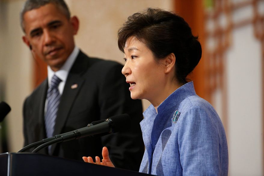 U.S. President Barack Obama listens as South Korean President Park Geun-hye speaks during a joint news conference at the Blue House in Seoul, South Korea, Friday, April 25, 2014. Obama, continuing his four-nation Asia trip which began in Japan, underscored warnings against North Korean nuclear provocations, calls to lower tensions in regional territorial disputes, and words of condolence for the ferry disaster victims and the people of South Korea. (AP Photo/Charles Dharapak)