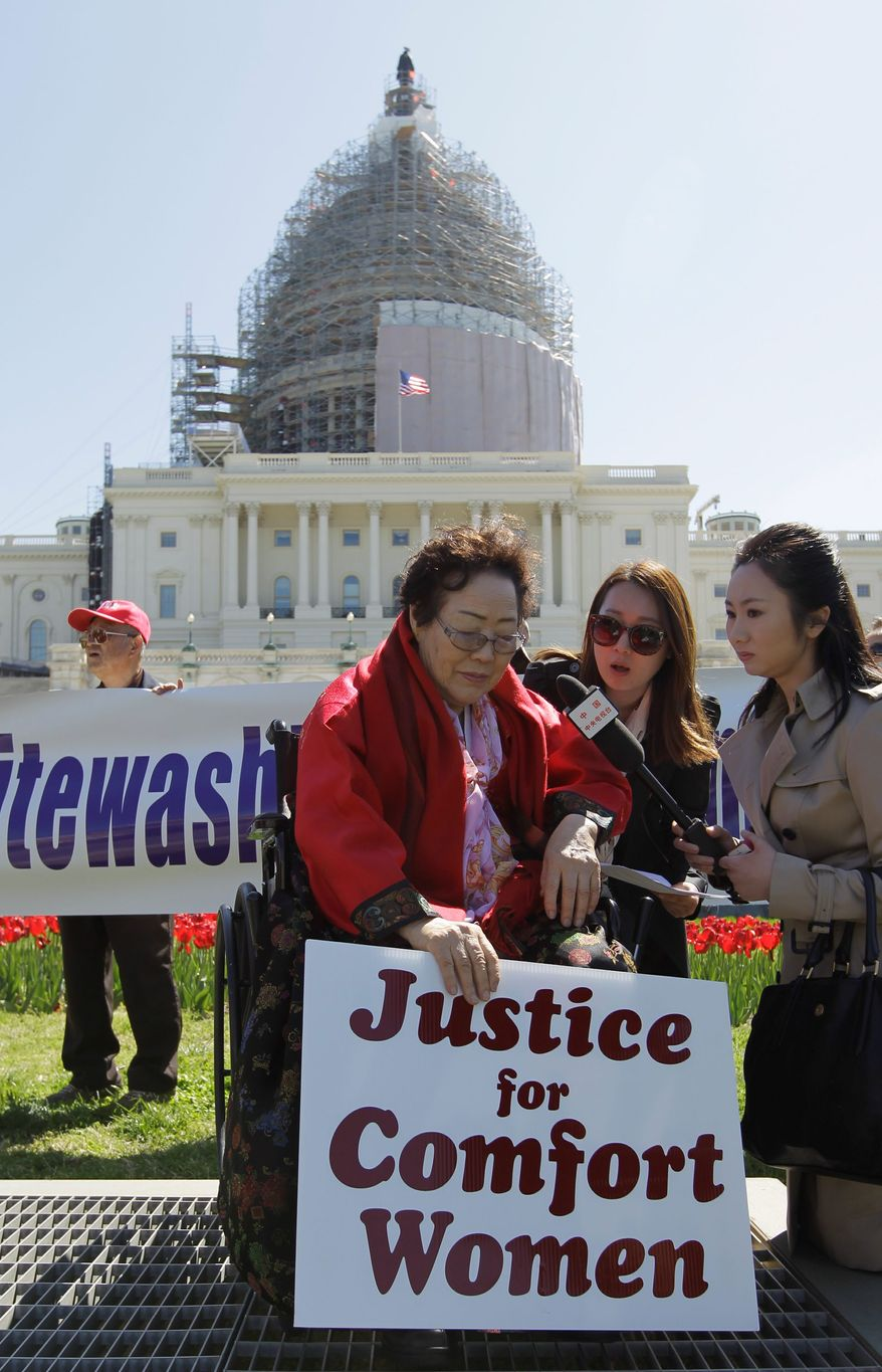 """Yong Soo Lee, of South Korea speaks to reporters on the West Lawn of Capitol Hill in Washington, Tuesday, April 28, 2015, Yong Soo Lee is one of dozens of surviving """"comfort women"""" from Korea other Asian countries that were forced into sexual servitude by Japanese troops. (AP Photo/Luis M. Alvarez)"""
