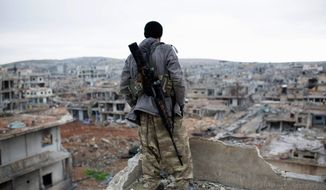 In this Jan. 30, 2015, file photo, a Syrian Kurdish sniper looks at the rubble in the Syrian city of Ain al-Arab, also known as Kobani. The Kurds of Syria and Iraq have become a major part of the war against the Islamic State group, with Kurdish populations in both countries threatened by the militants' advance. (AP Photo, File)