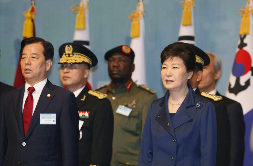 South Korean President Park Geun-hye, right, attends the 67th Armed Forces Day at Gyeryongdae, South Korea's main compound in Gyeryong City, South Korea, Oct. 1, 2015. (Kim Hee-chul/Pool Photo via AP)