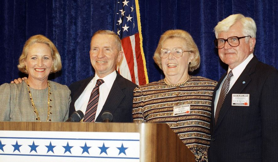 FILE - In this Sept. 28, 1992, file photo, Texas billionaire and presidential candidate Ross Perot and his wife Margot, left, pose with his vice-presidential running mate, Adm. James Stockdale and his wife Sybil in Dallas. Sybil Bailey Stockdale, a Navy wife who fought to end the torture of U.S. prisoners of war in Vietnam, has died. Stockdale's son, Sid, said Tuesday, Oct. 13, 2015, that his mother died Oct. 10 at a hospital after suffering from Parkinson's disease. She was 90. (AP Photo/Rick Bowmer, File)