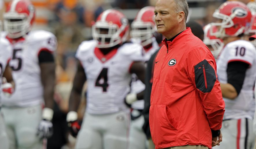 Georgia head coach Mark Richt watches as his team warms up before the start of an NCAA college football game against Tennessee Saturday, Oct. 10, 2015 in Knoxville, Tenn. (AP Photo/Wade Payne)
