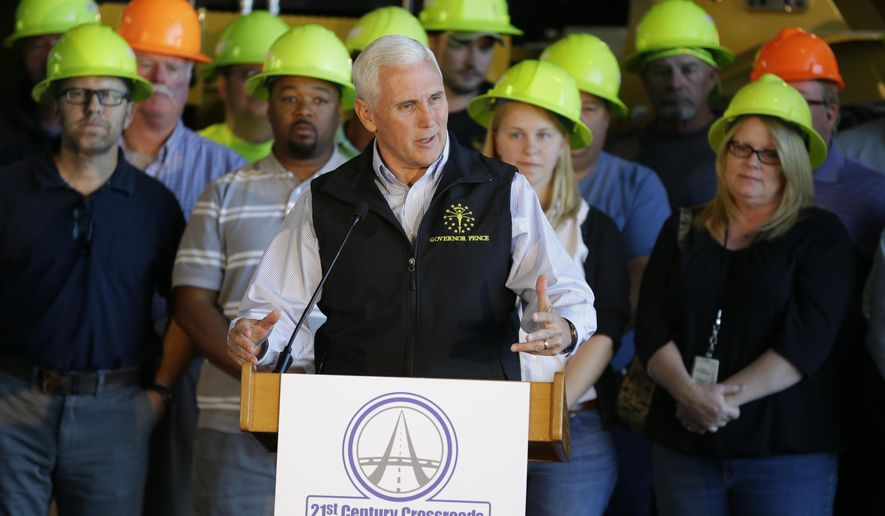 Indiana Gov. Mike Pence announces a 1 billion boost in state highway funding over four years at the Indiana Department of Transportation Traffic Management Center in Indianapolis, Tuesday, Oct. 13, 2015.  (AP Photo/Michael Conroy)