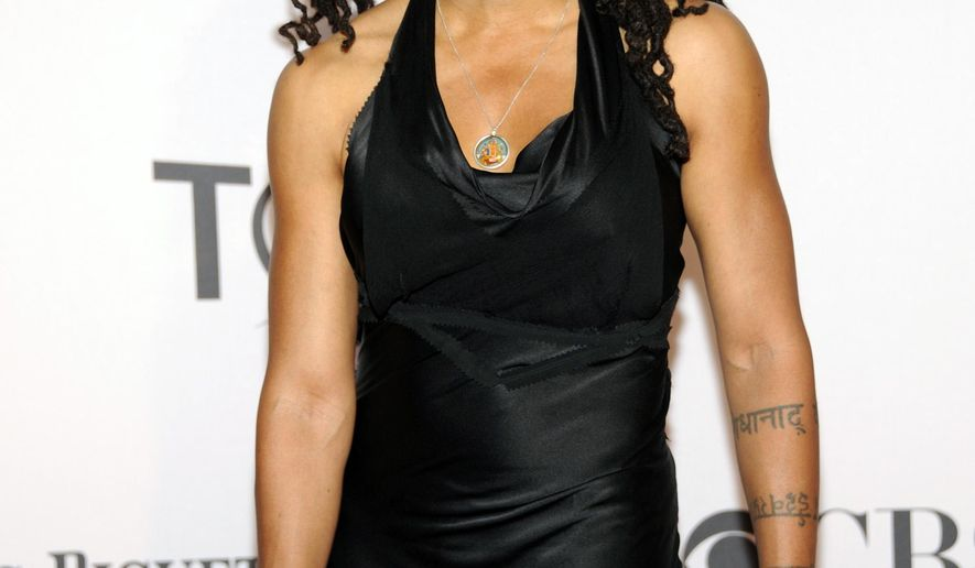 """FILE - In this June 10, 2012, file photo, playwright and screenwriter Suzan-Lori Parks arrives at the 66th Annual Tony Awards in New York. Parks has won the prestigious Dorothy and Lillian Gish Prize and its $300,000 prize, one of the largest cash awards in the arts. Parks, the first African-American woman to receive the Pulitzer Prize in Drama, wrote the play """"Topdog/Underdog,"""" adapted """"The Gershwins' Porgy and Bess,"""" and penned the screenplay for Spike Lee's """"Girl 6.""""(Photo by Evan Agostini/Invision/AP, File)"""