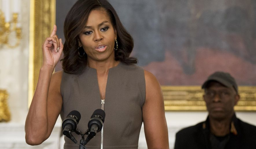 First lady Michelle Obama, speaks to welcome middle school students from the Washington area for an interactive student workshop, Wednesday, Oct. 14, 2015, in the State Dining Room of the White House in Washington. A concert at the White House marks 50th anniversary of the National Endowment for the Arts and Humanities. At right is Grammy award-winning blues musician Keb' Mo'. (Associated Press) **FILE**