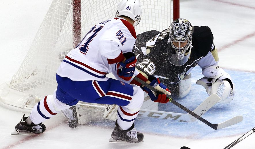 Pittsburgh Penguins goalie Marc-Andre Fleury stops a shot by Montreal Canadiens' Lars Eller (81) during the first period of an NHL hockey game in Pittsburgh Tuesday, Oct. 13, 2015.(AP Photo/Gene J. Puskar)