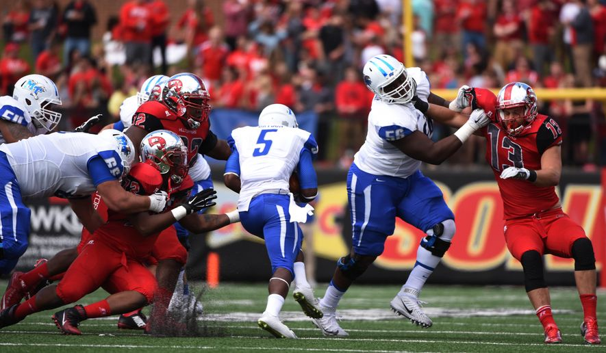 Middle Tennessee running back Jeremiah Bryson (5) center runs through a opening against the Western Kentucky during the first half an NCAA college football game on Saturday, Oct. 10, 2015, at L.T. Smith Stadium in Bowling Green, Ky. (AP Photo/Michael Noble Jr.)