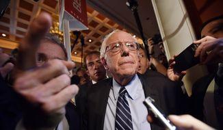 Sen. Bernie Sanders, of Vermont, speaks to the media after the CNN Democratic presidential debate Tuesday, Oct. 13, 2015, in Las Vegas. (AP Photo/David Becker)