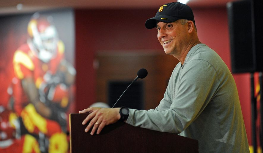 Southern California interim head coach Clay Helton speaks with the media during a press conference after an NCAA college football practice in Los Angeles Tuesday, Oct. 13, 2015. The Trojans offensive coordinator, Helton is taking over for head coach Steve Sarkisian, who was fired Monday. (AP Photo/Richard Hartog)