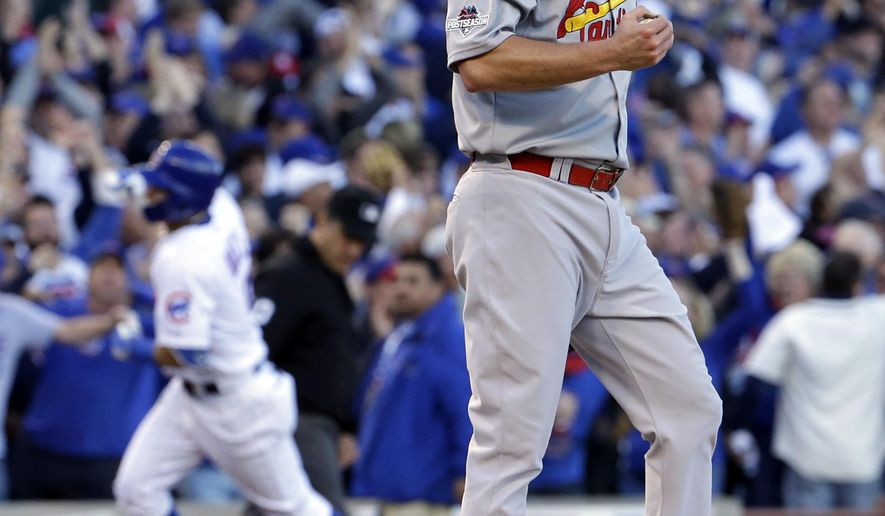 St. Louis Cardinals starting pitcher John Lackey (41) reacts after giving up a three-run home run to Chicago Cubs' Javier Baez, left, second inning of Game 4 in baseball's National League Division Series, Tuesday, Oct. 13, 2015, in Chicago. (AP Photo/Nam Y. Huh)