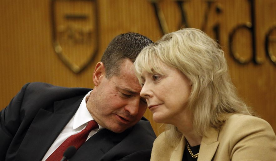 State Superior Court Judges David Wecht, left, and Christine Donohue talk before a Pennsylvania Supreme Court debate, Wednesday, Oct. 14, 2015, at the Widener University Commonwealth Law School in Harrisburg, Pa.  On Nov. 3, 2015, voters will fill three vacancies on the seven-member state Supreme Court.  (AP Photo/Matt Slocum)