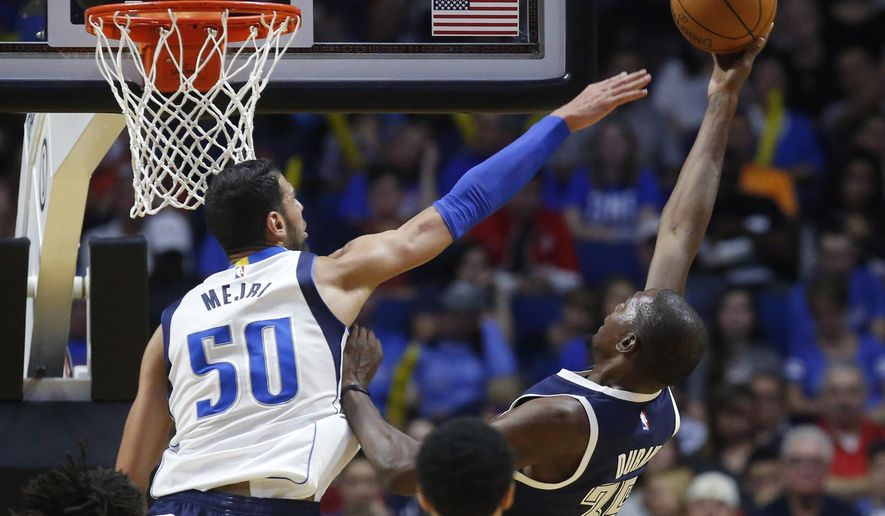 Oklahoma City Thunder forward Kevin Durant (35) shoots as Dallas Mavericks center Salah Mejri (50) defends in the third quarter of an NBA basketball preseason game in Tulsa, Okla.,Tuesday, Oct. 13, 2015. Oklahoma City won 100-88. (AP Photo/Sue Ogrocki)