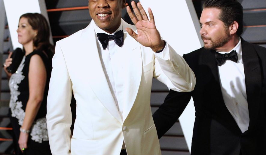 "FILE - In this Feb. 23, 2015 file photo, Jay Z arrives at the 2015 Vanity Fair Oscar Party in Beverly Hills, Calif. The rapper appeared in a Los Angeles federal court on Tuesday, Oct. 13, 2015, for the start of a copyright infringement trial in which he and music producer Timbaland are accused of violating the rights of famed Egyptian composer Baligh Hamdi to create their 1999 hit ""Big Pimpin'."" (Photo by Evan Agostini/Invision/AP, File)"