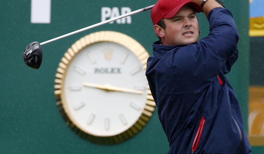 United States' Patrick Reed watches his tee shot on the first hole during his singles match against International team player Louis Oosthuizen of South Africa at the Presidents Cup golf tournament at the Jack Nicklaus Golf Club Korea, in Incheon, South Korea, Sunday, Oct. 11, 2015.(AP Photo/Lee Jin-man)