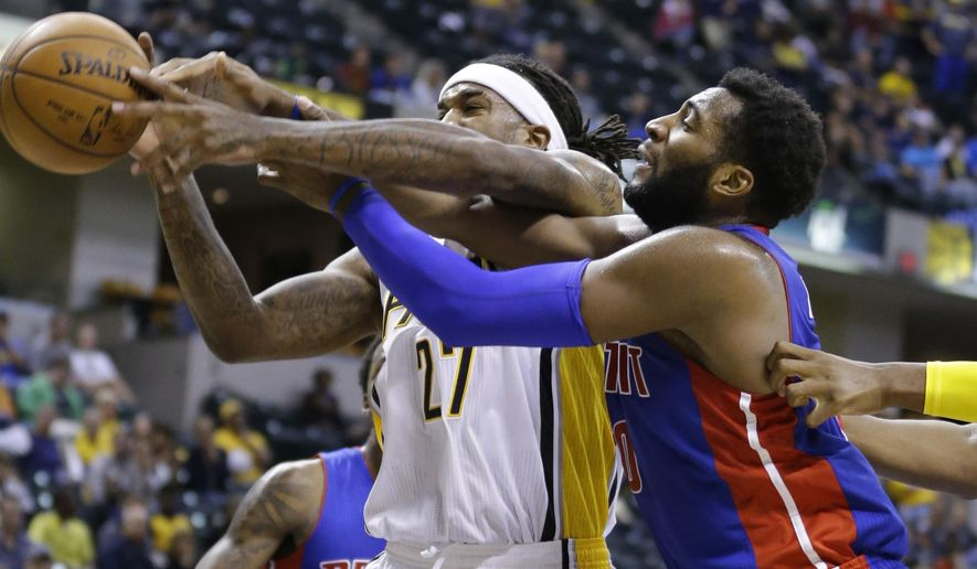 Indiana Pacers center Jordan Hill (27) is fouled by Detroit Pistons center Andre Drummond (0) during the second half of an NBA preseason basketball game in Indianapolis, Tuesday, Oct. 13, 2015. The Pacers defeated the Pistons 101-97. (AP Photo/Michael Conroy)