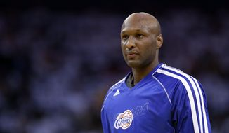 FILE - This Jan. 2, 2013 file photo shows Los Angeles Clippers' Lamar Odom (7) in action against the Golden State Warriors during an NBA basketball game in Oakland, Calif. Authorities say former NBA and reality TV star Odom has been hospitalized after he was found unconscious at a Nevada brothel. Nye County Sheriff Sharon A. Wehrly says the department got a call Tuesday afternoon, Oct. 13, 2015, requesting an ambulance for an unresponsive man at the Love Ranch in Crystal, Nevada about 70 miles outside of Las Vegas.  (AP Photo/Marcio Jose Sanchez, File)