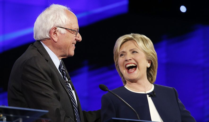 Sen. Bernie Sanders, of Vermont, left, and Hillary Rodham Clinton laugh during the CNN Democratic presidential debate, Tuesday, Oct. 13, 2015, in Las Vegas. (AP Photo/John Locher) ** FILE **