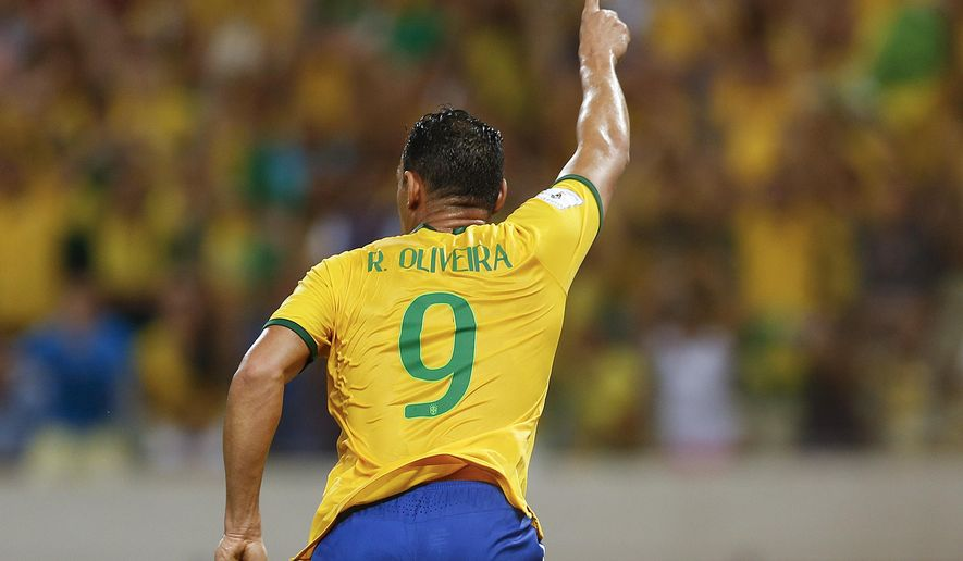 Brazil's Ricardo Oliveira celebrates after scoring against Venezuela during a 2018 World Cup qualifying soccer match in Fortaleza, Brazil, Tuesday, Oct. 13, 2015. (AP Photo/Andre Penner)