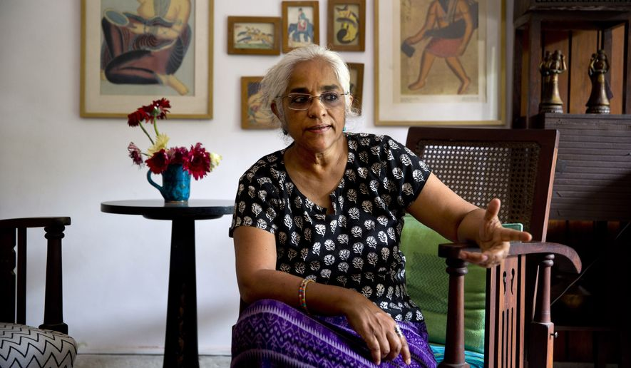 Indian playwright and theater artist Maya Krishna Rao rests at her residence in New Delhi, India, Wednesday, Oct. 14, 2015. As of Wednesday, 41 novelists, essayists, playwrights and poets writing in English as well as regional languages, have returned the awards they received from India's prestigious literary academy in protest, saying they cannot remain silent any longer about numerous incidents of communal violence or attacks on intellectuals across the country over the past year. (AP Photo/Saurabh Das)