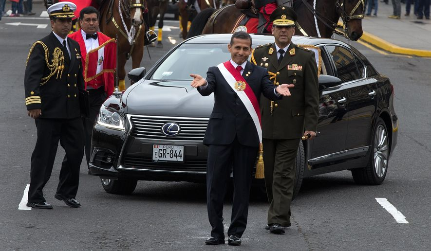 Peru's President Ollanta Humala gestures to the press to move back and give him space to walk before delivering his last State of the Nation address to congress on Independence Day in Lima, Peru, in this July 28, 2015, file photo. (AP Photo/Martin Mejia, File)