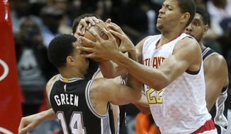 Atlanta Hawks center Walter Tavares (22 and San Antonio Spurs guard Danny Green (14) battle for control of the ball in the first first half of an NBA preseason basketball game Wednesday, Oct. 14, 2015, in Atlanta. (AP Photo/John Bazemore)