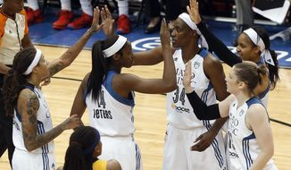 Minnesota Lynx players celebrate a play against the Indiana Fever in the first half of Game 5 of the WNBA basketball finals, Wednesday, Oct. 14, 2015, in Minneapolis. (AP Photo/Stacy Bengs)