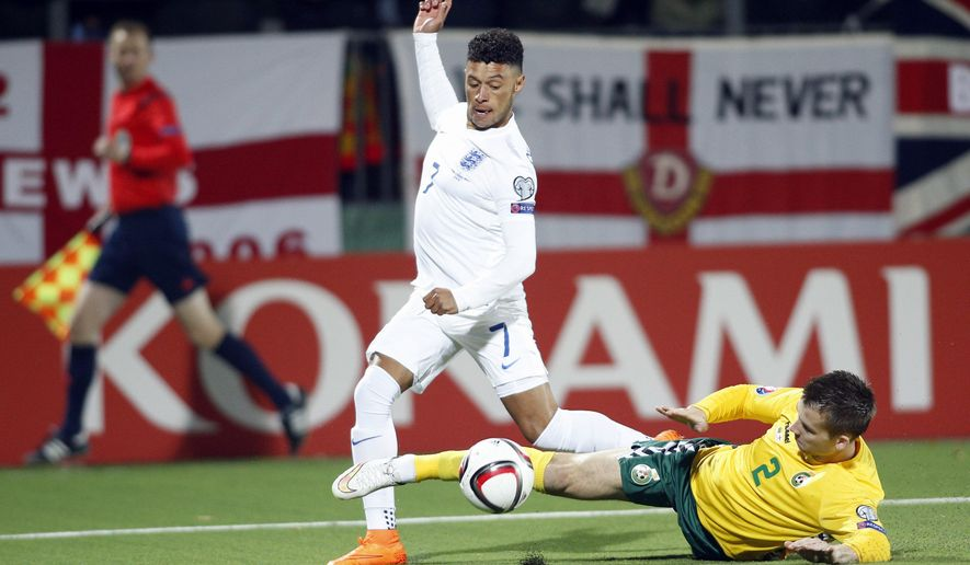 Lithuania's Georgas Freidgeimas, right, and England's Alex Oxlade Chamberlain challenge for the ball during the Euro 2016 group E qualifying soccer match between the Lithuania and England at the LFF stadium in Vilnius, Lithuania, Monday, Oct. 12, 2015. (AP Photo/Mindaugas Kulbis)