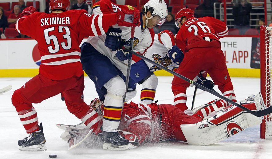 Carolina Hurricanes' Jeff Skinner (53) pushes Florida Panthers' Jaromir Jagr (68) of Czech Republic into goalie Eddie Lack (31) and is called for holding, during the first period of an NHL hockey game, Tuesday, Oct. 13, 2015, in Raleigh, N.C. (AP Photo/Karl B DeBlaker)