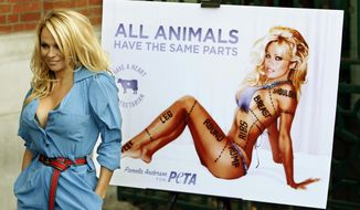 In this Oct. 24, 2010 photo, Canadian-born actress Pamela Anderson poses for photographers during a photocall to unveil a new advertisement in aid of People for the Ethical Treatment of Animals (PETA) in London to encourage people to go vegetarian. PETA turns 35 years old in 2015, is the largest animal rights group in world with 3 million members, and has done a lot with a little sex, shock and celebrity. (AP Photo/Akira Suemori, File)
