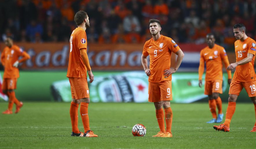 Dutch players react after the Czech Republic scored it's third goal during the Euro 2016 qualifying match between the Netherlands and the Czech Republic, at the ArenA stadium, in Amsterdam, Netherlands, Tuesday, Oct. 13, 2015. The Dutch team, which finished third in the 2014 Brazil World Cup, lost 3-2, failed to qualify directly and did not secure a place in the play-offs for the Euro 2016. (AP Photo/Peter Dejong)